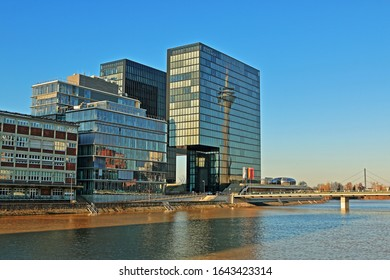 Reflection of the Düsseldorf Rhine Tower in a glass facade