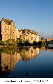 Reflection in the river of Espalion old palace in Aubrac, France
