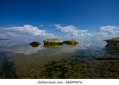Reflection of rocks in the water