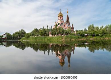 Reflection of a Russian Orthodox church in Almaty, Kazakhstan