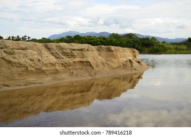 Reflection of sand on river water