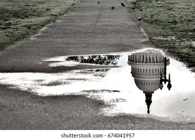 A reflection shot turns the US Capitol upside down