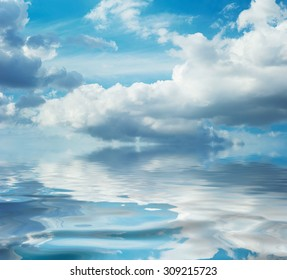 Reflection of the sky in calm water. Daytime for daydreaming. Imagination. Mirror of the shallow sea. Tranquil romantic seascape. Shoal area. Idillic marine scene. Ripple on ocean surface.