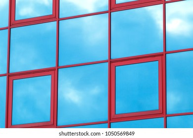 Reflection of the sky and clouds on the glass wall of the buildi
