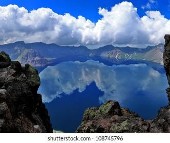 Reflection of sky at Heaven Lake on top of Changbai Mountain or Baekdu Mountain overlooking North Korea from Jilin Province, China.