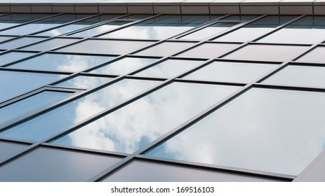 Reflection of the sky in the windows of office building