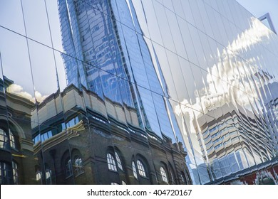 reflection of skyscrapers in the Windows of houses