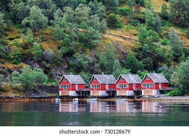 Reflection of a small houses in a norwegian fiord, Norway
