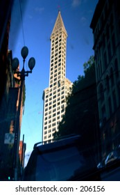 reflection of smith tower (seattle) in car window