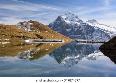 Reflection of snow-capped mountain on a still lake