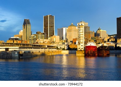 Reflection of the sun at daybreak, on part of the port and city of Montreal.