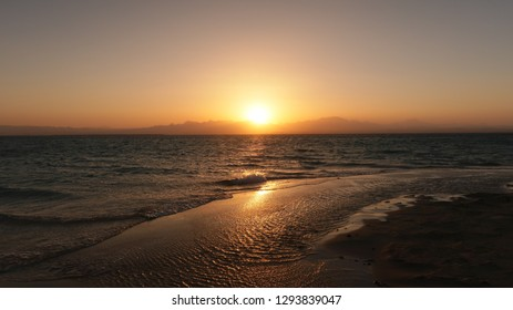 Reflection of the sun rays in the sea on the coast of the Red Sea in Egypt