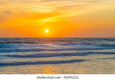 Reflection of sunlight on the surface of the sea at sunset