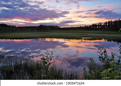 reflection of sunset in the lake surface