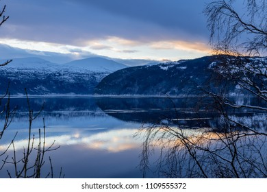 Reflection of sunset and mountains in lake
