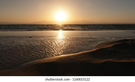 Reflection of the sunset on the coast of the Red Sea in Egypt