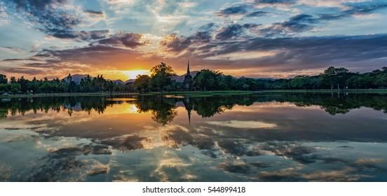 Reflection of sunset of Sukhothai historical park