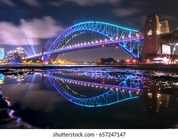 Reflection of The Sydney Harbour Bridge in a puddle, Sydney Australia