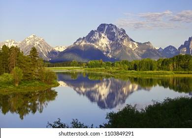 Reflection of Teton mountain range in Snake River, Wyoming