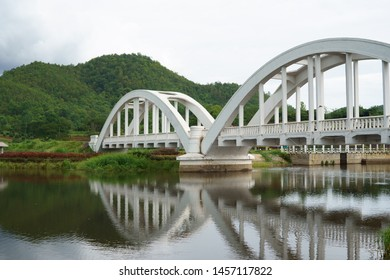 reflection of The Tha Chomphu Railway Bridge or White Bridge, railway bridge in Mae Tha District, Lamphun, history landmark of Thailand