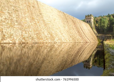 Reflection of the tower and wall on Derwent Dam that is in The  Peak District National Park, Derbyshire, UK.