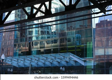 Reflection of a train in a glass window of a skyscraper in Chicago