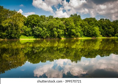 Reflection of trees and clouds in the Potomac River, at Balls Bluff Battlefield Park in Leesburg, Virginia