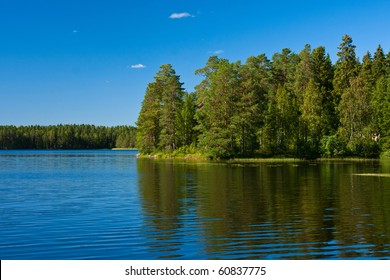 Reflection of trees in lake in Finland
