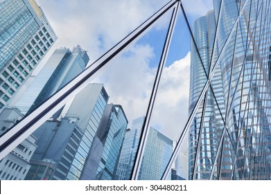 Reflection of urban skyline on modern office building