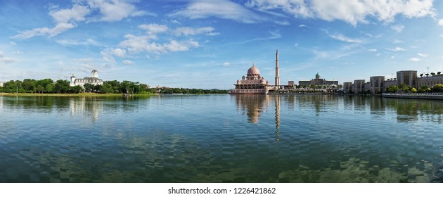 reflection view of putra mosque during sunny day wuth blue sky at background with panoramic concept at putrajaya Malaysia.