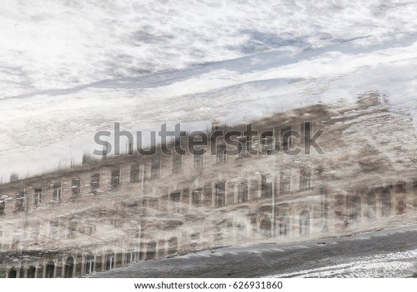 Reflection of vintage house in frozen fontanka river