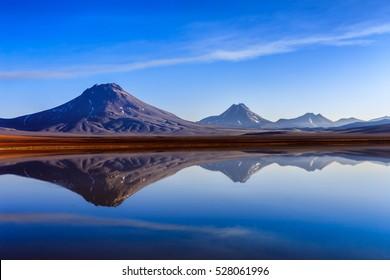 Reflection of vulcanos in the Lejia Lake, Atacama, Chile
