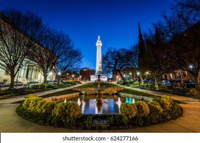 Reflection of the washington Monument from the pond in Mount Vernon Baltimore, Maryland at night