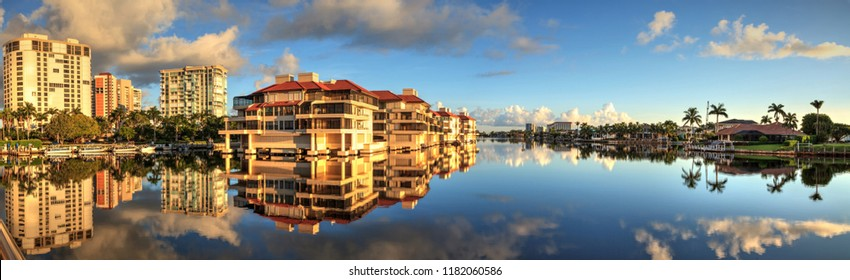 Reflection in the water of buildings along the Village at Venetian Bay in Naples, Florida.