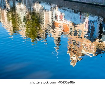 Reflection in water of buildings in main red light district in Amsterdam, Netherlands