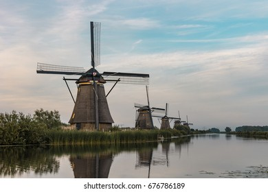 reflection in the water by the Famous Dutch wooden windmills  Kinderdijk Holland. Summer evening  countryside.Colorful outdoor scene Netherlands, Europe.UNESCO World Heritage.