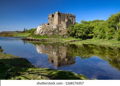 Reflection in water of Dunvegan castle, Scottland