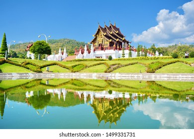 The reflection in the water of the gilded glass In Chiang Mai