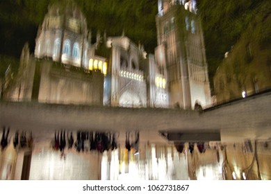 reflection in the water at very low speed, of the cathedral of toledo, with slight movements of camera to give artistic sensation to the subject,