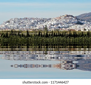 reflection in the water of the white village of Salobreña, Granada, Andalucia, Spain, white village typical of the Mediterranean,