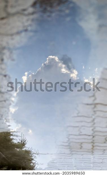 reflection-white-cloud-blue-sky-600w-203