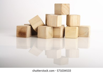 Reflection of Wooden Block on White Background