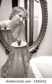 Reflection of a young woman in wedding dress with sepia finish