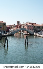 Reflections along the canals of Chioggia, Venice and its lagoon.