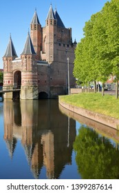 Reflections of the Amsterdamse Poort city gate (built between 1400 and 1500) in Haarlem, Netherlands