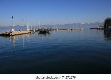 Reflections in the boat harbour, Lake Geneva