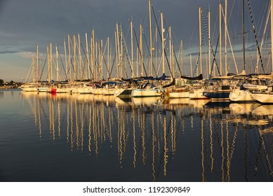 Reflections of boats at dusk