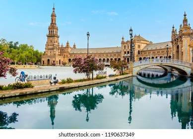 Reflections in the canal in the Plaza de Espana in Seville, Spain in the early morning in summertime
