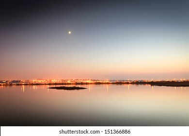 Reflections of city lights on the tagus river.