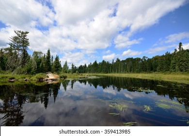 Reflections of Clouds on a Wilderness River